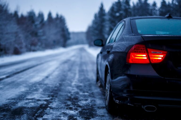 black-car-iced-road-surrounded-by-trees-covered-with-snow (1)